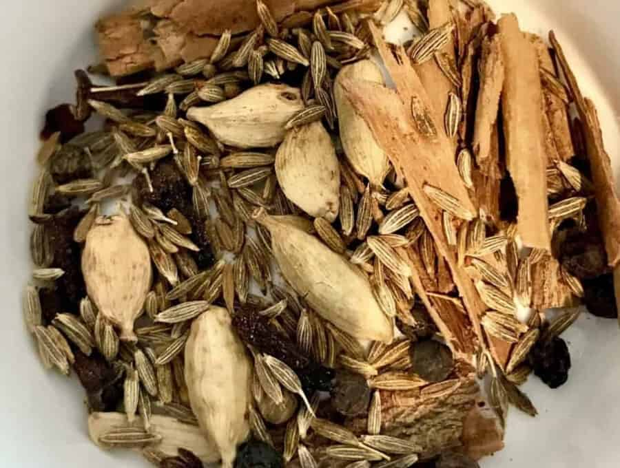 Overhead picture of whole spices used in Chicken Biryani recipe.