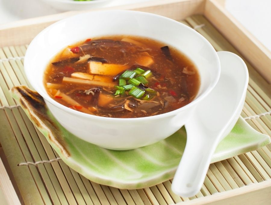 Keto hot and sour soup in a white bowl