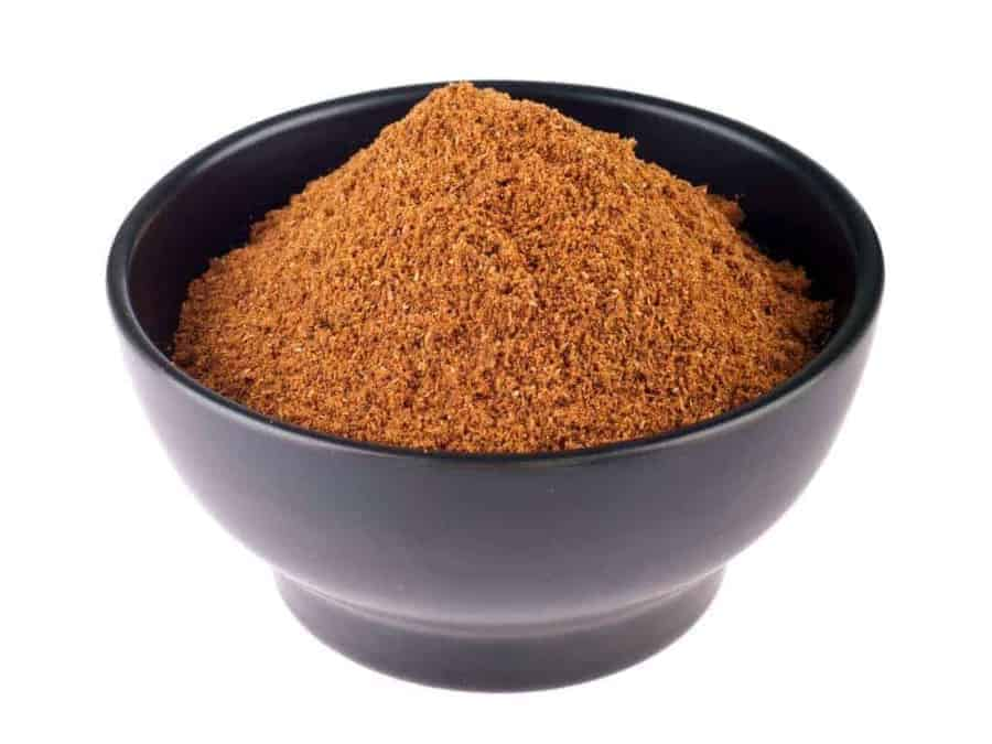 homemade garam masala recipe with masala in a black bowl