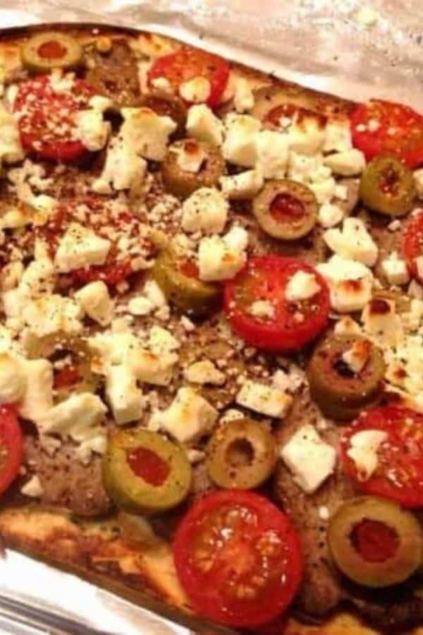 Greek Pizza on a metal platter
