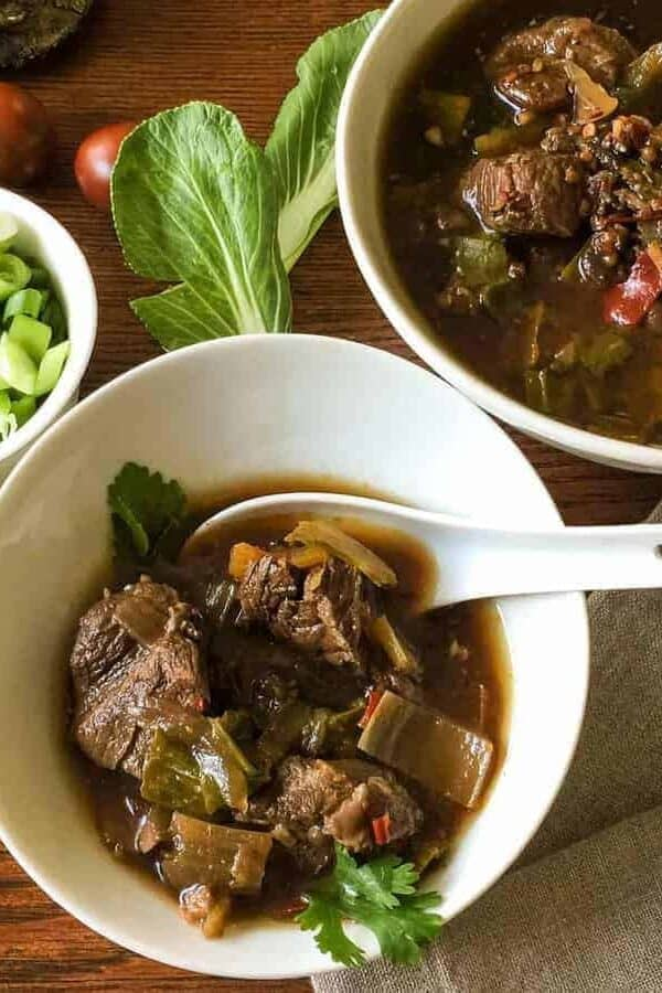 Flavorful, low carb version of Szechuan Pork Soup substitutes bok choy for the noodles, while keeping the traditional flavors of this soup. Pressure cooking makes the meat super tender.