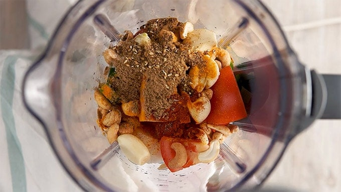 Instant Pot Chicken Korma place veggie nuts and spices in a blender