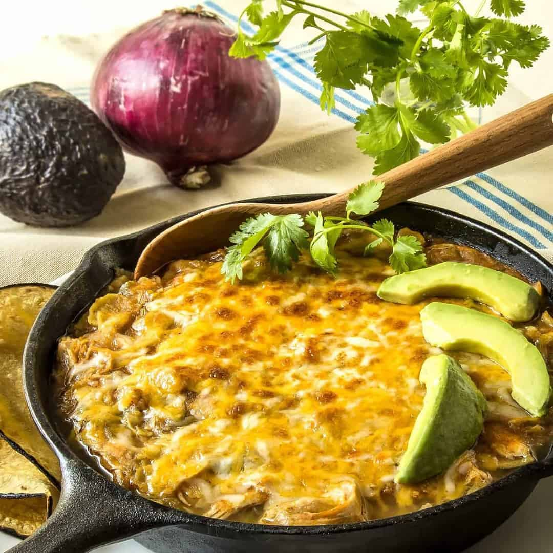 This Pressure Cooker Chicken Enchilada Casserole is so perfect for a busy day. Put everything into the pressure cooker, and then broil the cheesy topping for a few minutes for all of the taste of Chicken Enchiladas, with half the effort.