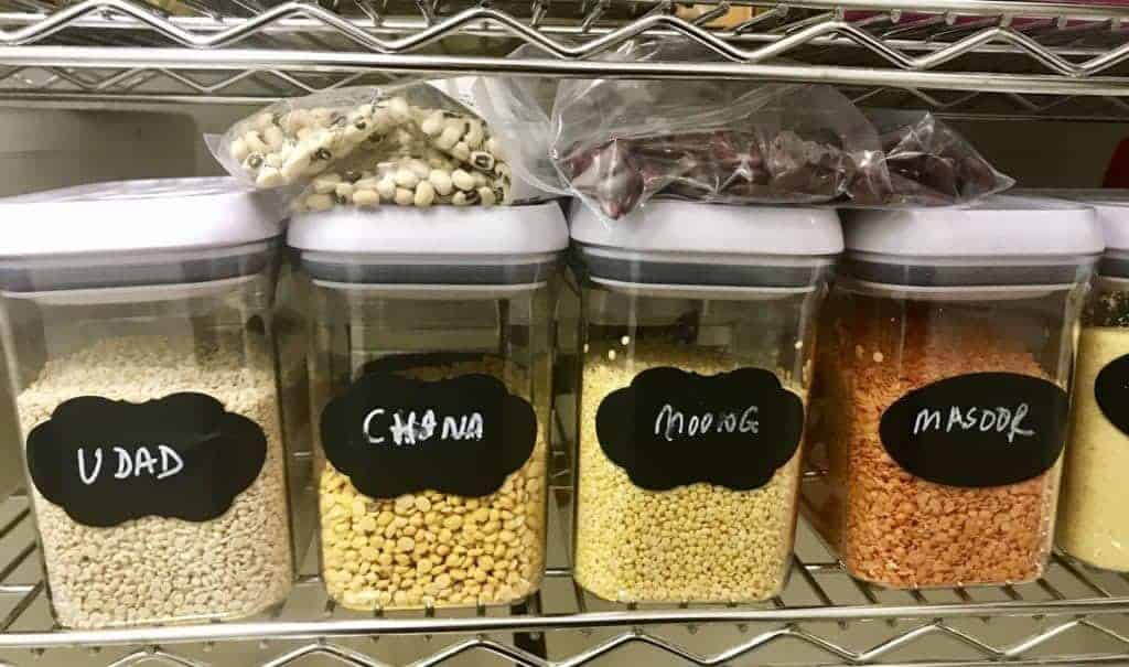 Containers of Lentils on a shelf.