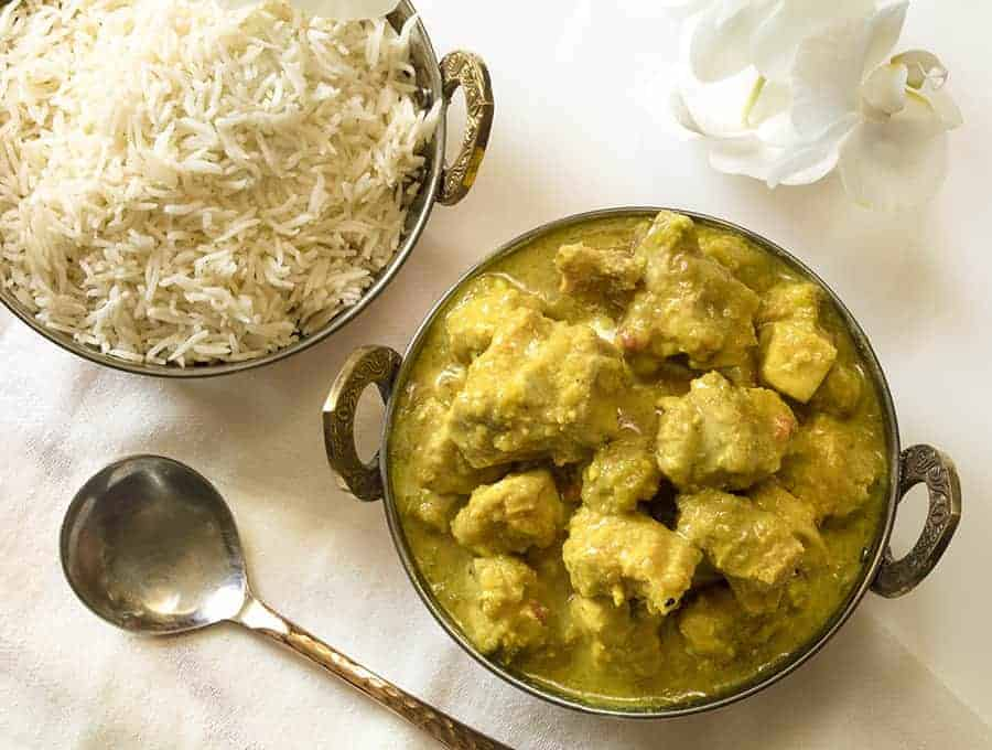 Instant pot chicken korma overhead view with rice in the background