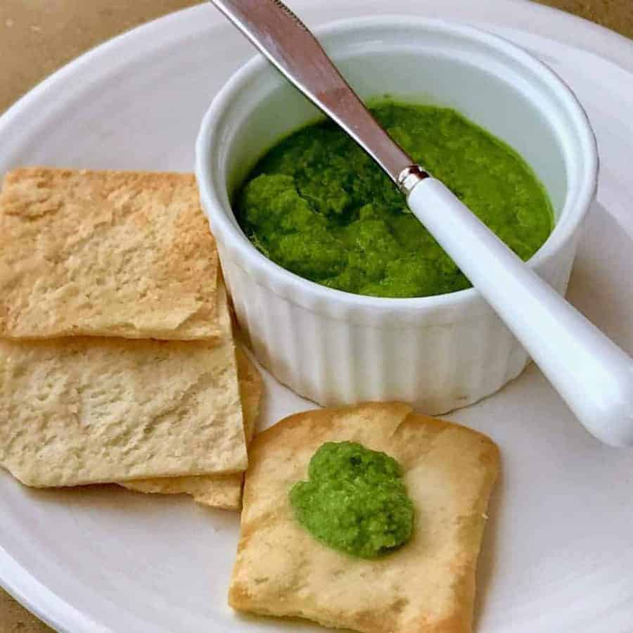 Indian Green Chutney in a bowl with bread.