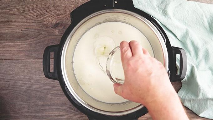 Paneer process shot showing ingredients in pot