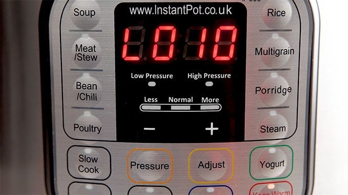 Close up of instant pot controls.