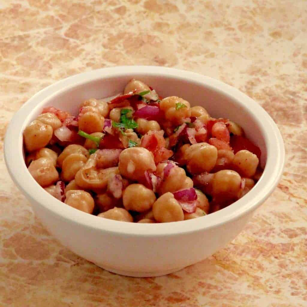 Pressure cooker Chickpea salad is a delicious, healthy vegan recipe that is perfect for summer. 20 minutes in your pressure cooker to make the most delicious, tender chickpeas you've ever had.