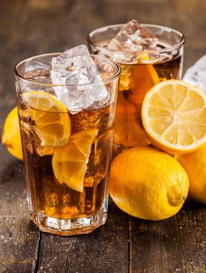 Two glasses of Iced Tea with lemons.