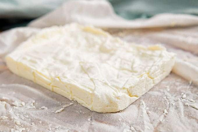 block of paneer sitting on top of cheesecloth