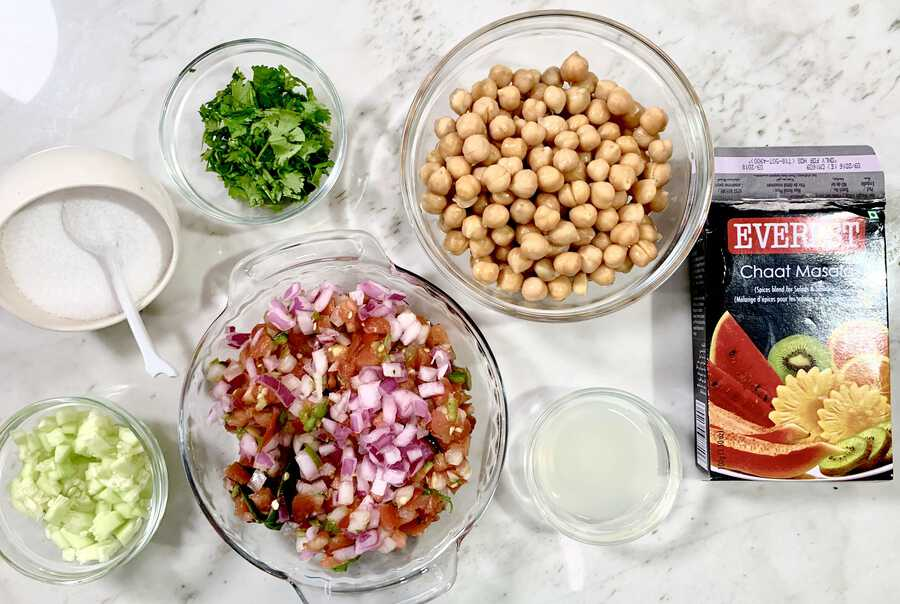 Chaat masala, cucumber, tomatoes and onions, salt, cilantro, lime juice, and chickpeas.