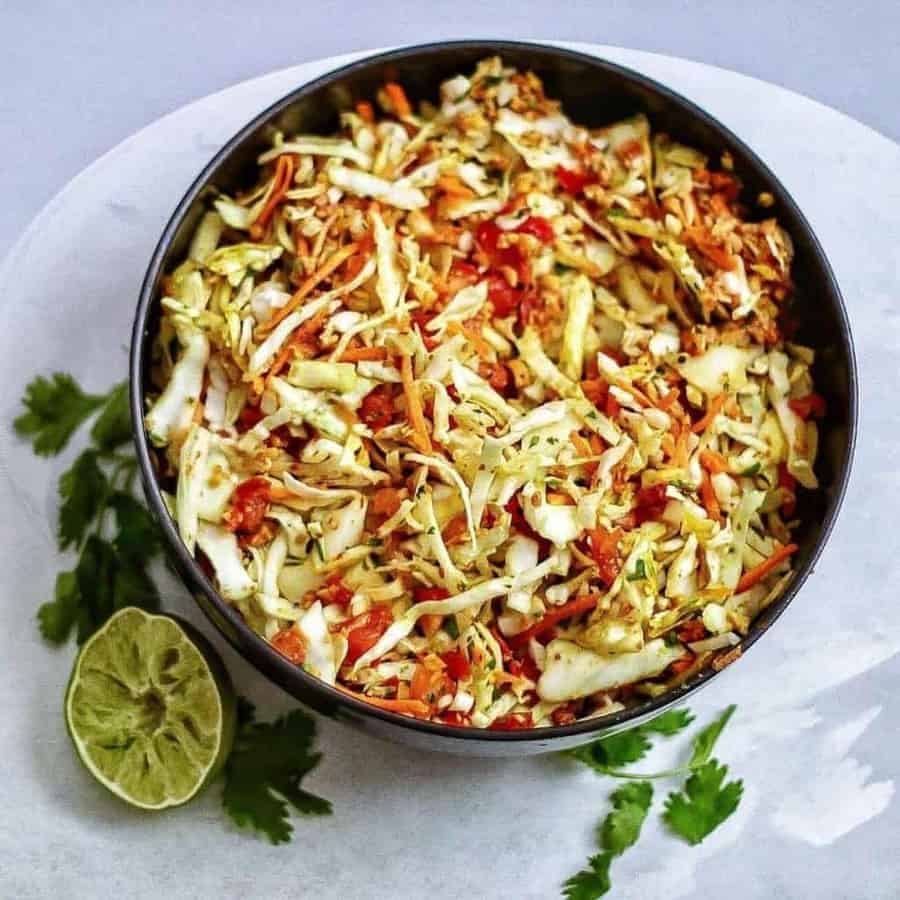 Indian style raw cabbage peanut slaw makes a great accompaniment to any meal. One of my favorite summer salads!  twosleevers