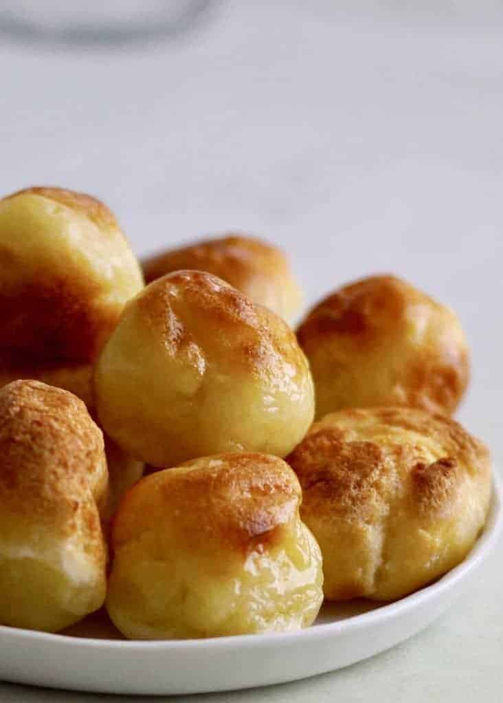 Instant Pot Pao de Quiejo to make the famous Brazilian cheese bread at home. This gluten-free delight is steamed and then broiled. Just tapioca flour, milk, oil, eggs, and cheese make up this delightful bread.