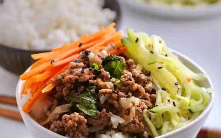 Cook a spicy basil beef along with a pot of rice at the same time in your pressure cooker. Make a quick-pickled salad while they cook, to serve a healthy, fast dinner.