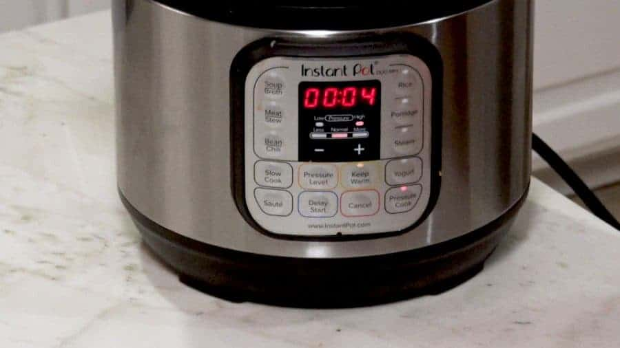 Instant Pot panel showing 4 minutes on timer