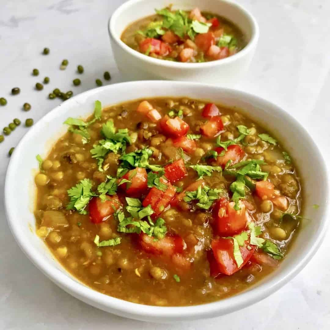 This recipe for Indian Moong Dal cooks so fast in your pressure cooker or Instant Pot, that it makes this hearty, protein-rich dal easy to make for weeknight dinners. This recipe allows you to harness the power of your pressure cooker to skip several stovetop steps, without compromising flavor.