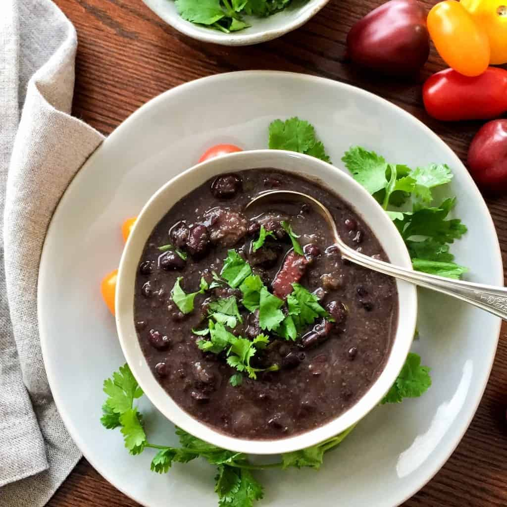 Pressure cooker Black Bean soup combines a handful of ingredients for a very tasty, easy, dump and cook soup.