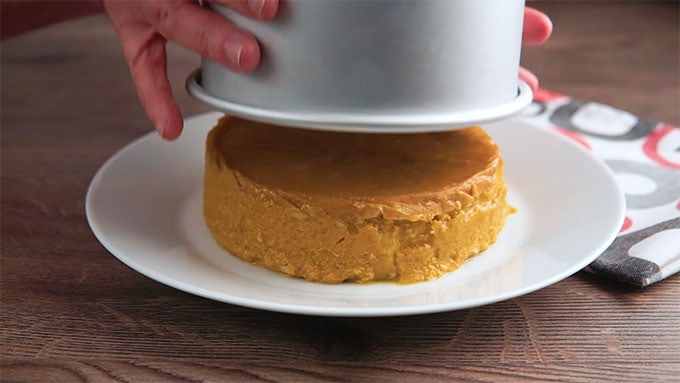 Side shot of removing the finished Low Carb Pumpkin Pie from the pan.