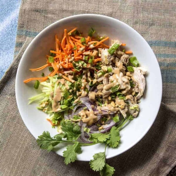 Instant Pot Low carb sesame ginger chicken is very versatile. Eat it plain, over zoodles, with rice, or in a lovely crunchy salad.