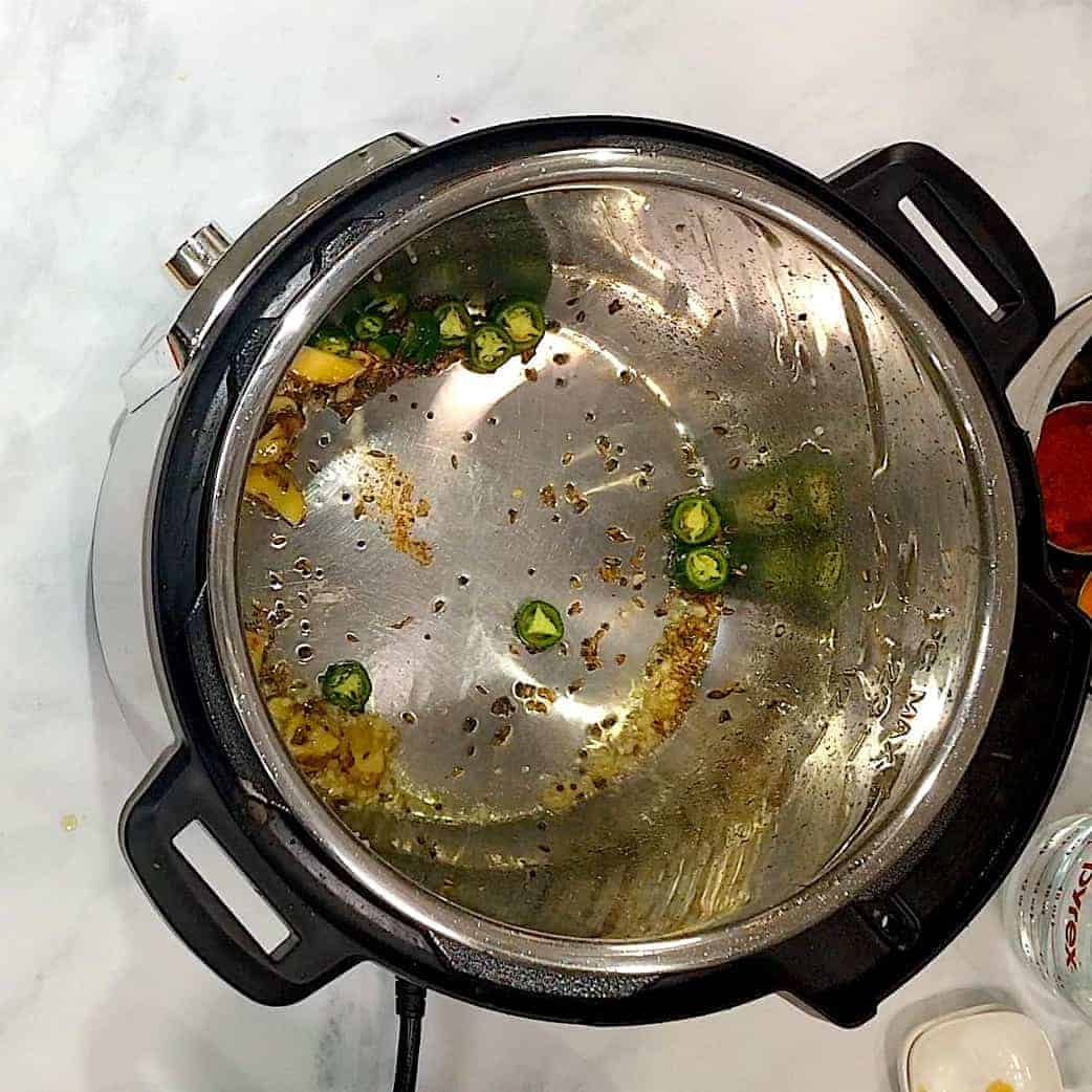 Inside of a Pressure Cooker with leftover rice and dal.