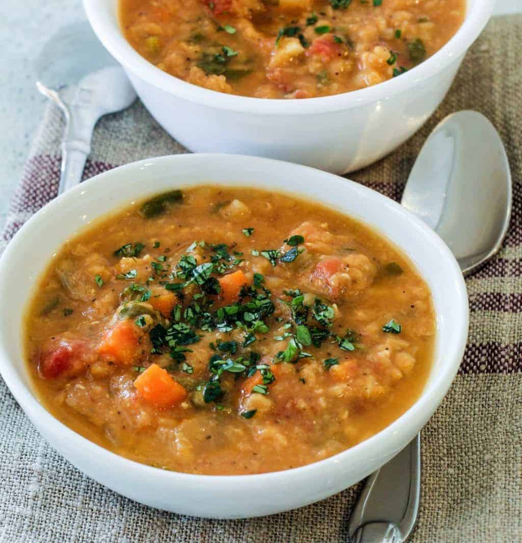 two bowls of creamy red lentil soup