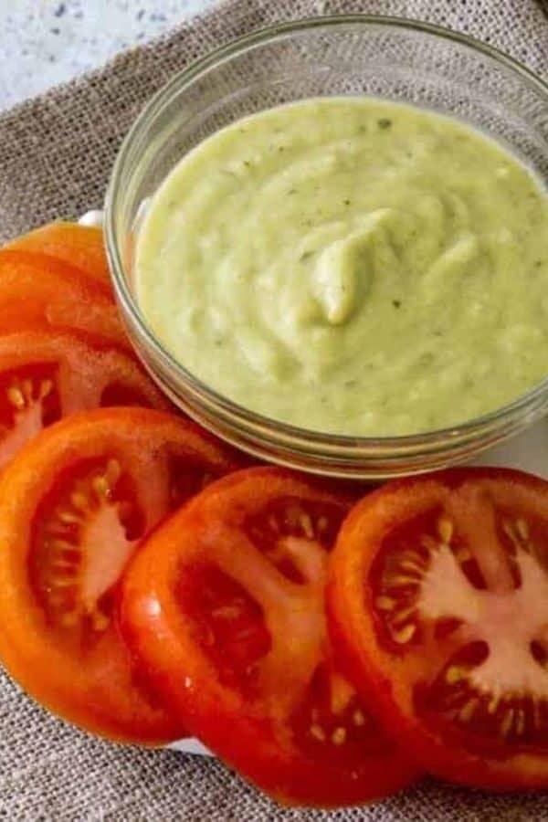 Creamy avocado salsa in a glass bowl