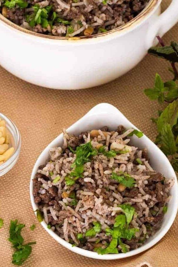Lebanese hashweh combines ground meat and rice with pine nuts, allspice and other spices to make a wonderful side dish, or a flavorful stuffing for chicken or turkey. An easy one-step recipe can be made in a Pressure cooker, the Instant Pot Gem, or stovetop.
