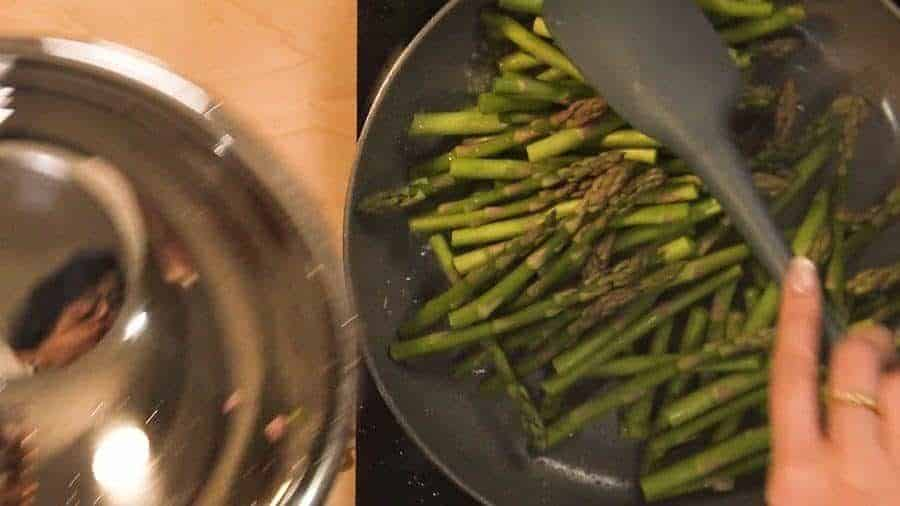 Overhead shot of adding the oil, garlic, ginger, and asparagus to a hot pan.