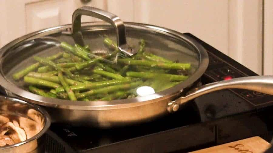 Side shot of cooking the asparagus.