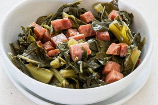 Southern Style Collard Ham and Greens. No need to miss your beans and greens with this low carb ham and greens recipe! Simple dump and cook recipe for your Instant Pot or Pressure Cooker makes a tasty side dish in under 30 minutes.