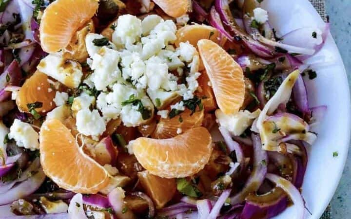 Pickled Red onion, Oranges salad with Feta cheese,  Mint, and cilantro. Date night food it is not. But let's be honest. We've all been on dates we would have gladly traded for a salad. This would be that salad.