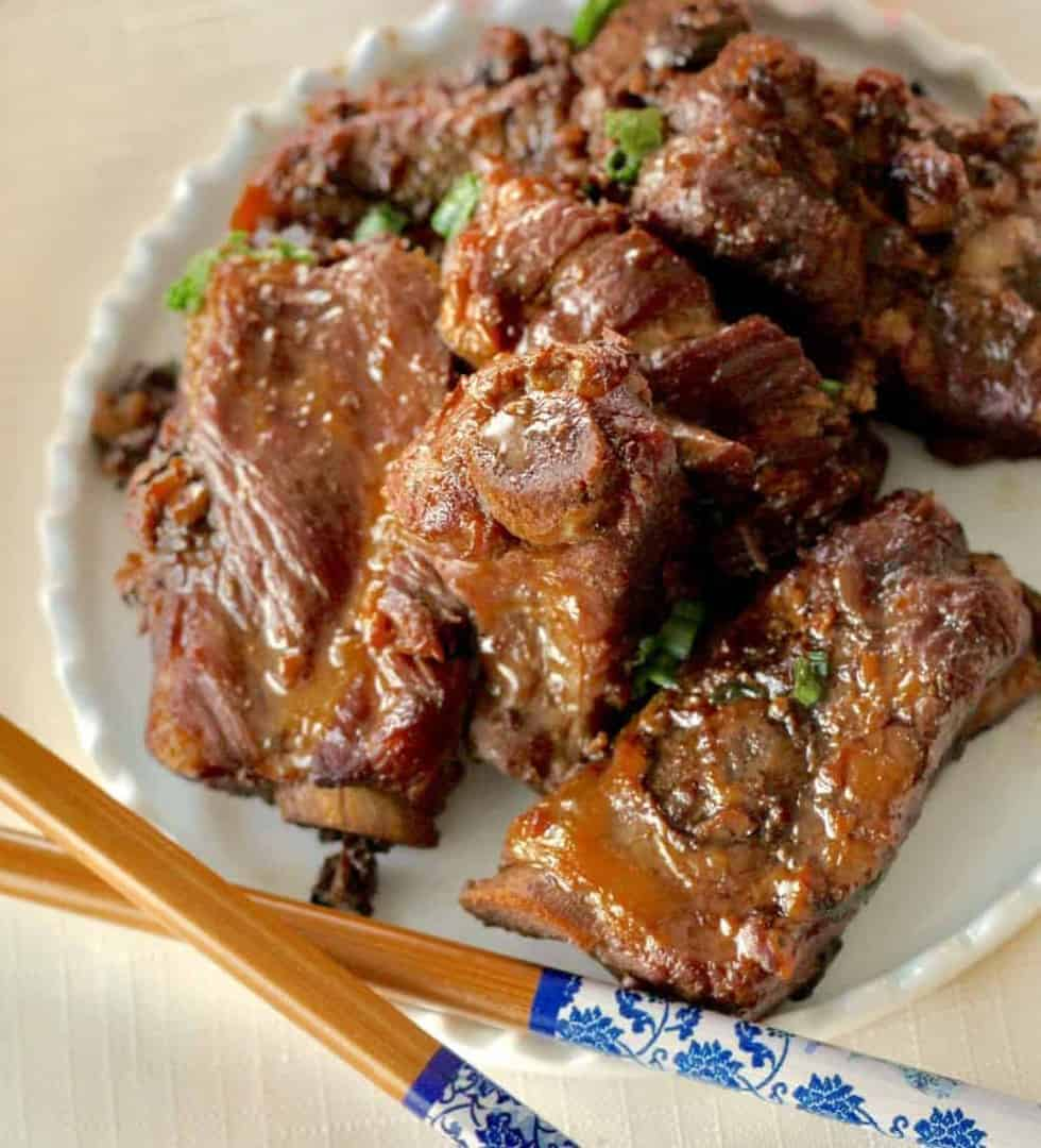 Instant Pot or Pressure Cooker Keto Chinese Braised spareribs are meaty little ribs with a great, rich, deep flavor. These are ribs braised in a deep, dark flavorful black bean sauce that coats the ribs with umami goodness. Super easy dump and cook recipes for your Instant Pot or pressure cooker.