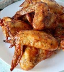 Tangy, sweet, spicy air fryer chicken wings with Gochujang make a delightful easy keto appetizer or meal. Make thee in your air fryeror oven and enjoy the finger-licking goodness.