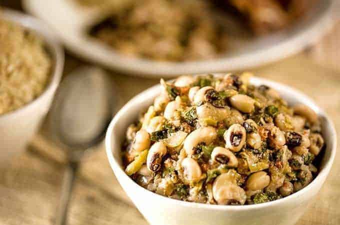 Instant Pot Kenyan Kunde is a nutritious recipe with black-eyed peas and peanuts in a white bowl sideways shot
