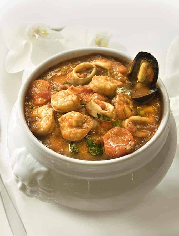 Cioppino Seafood Stew in a white bowl