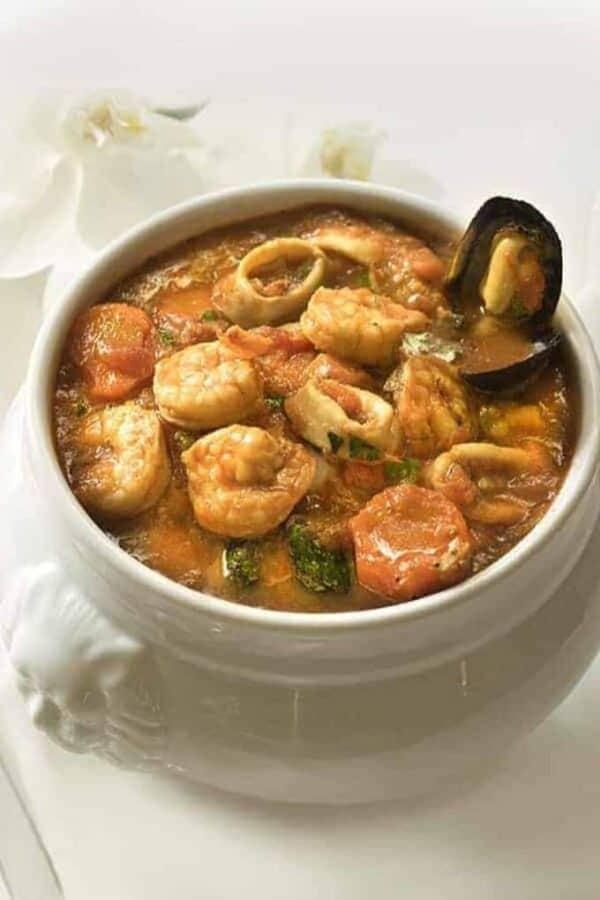 A bowl of Clam Chowder with shrimp.