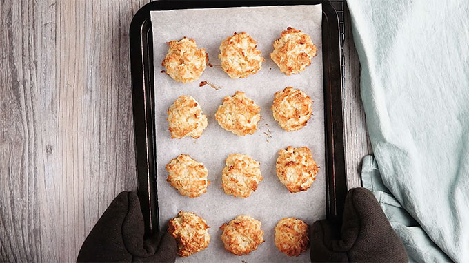 Keto Coconut Macaroons on a baking sheet with parchment paper