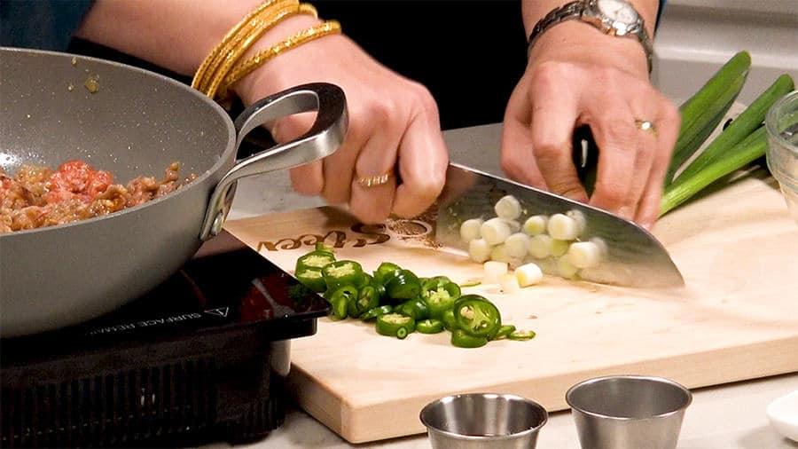 Chop green chilis and onions
