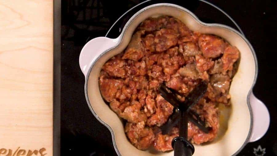 Overhead shot of Italian sausage in a flower-shaped pan