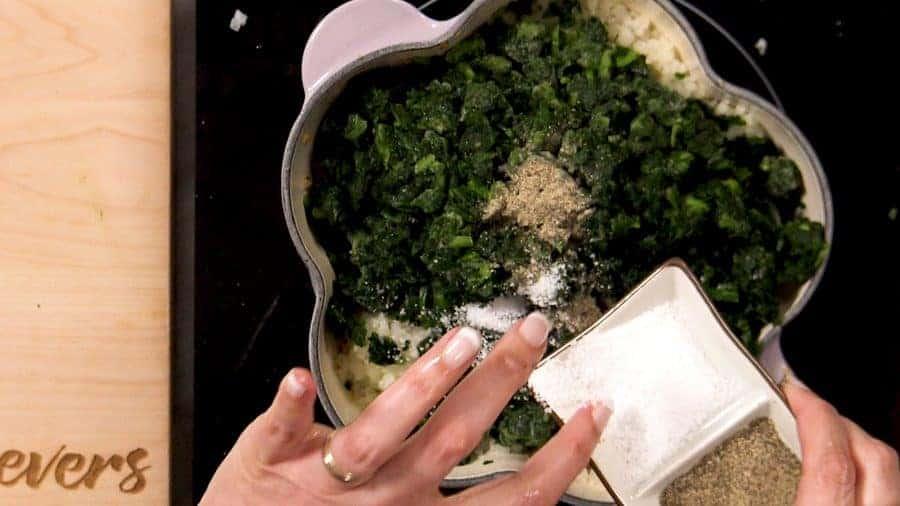 Adding spinach and seasoning
