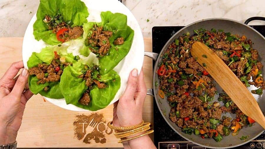 Overhead shot of finished stir fry in lettuce cups.