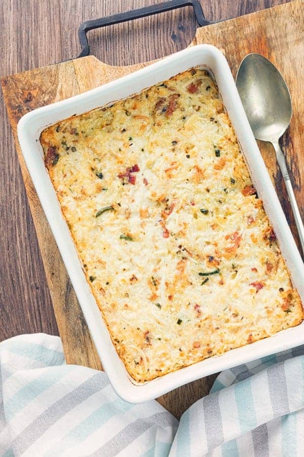 Cauliflower mac and cheese casserole in a white dish overhead view