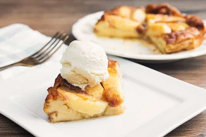 German Apple Pancakes with Ice cream on top, Side view, served on a white platter