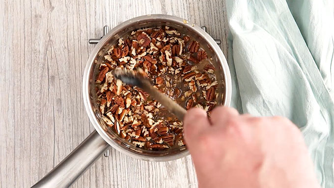 chopped pecans as a filling in a saucepan