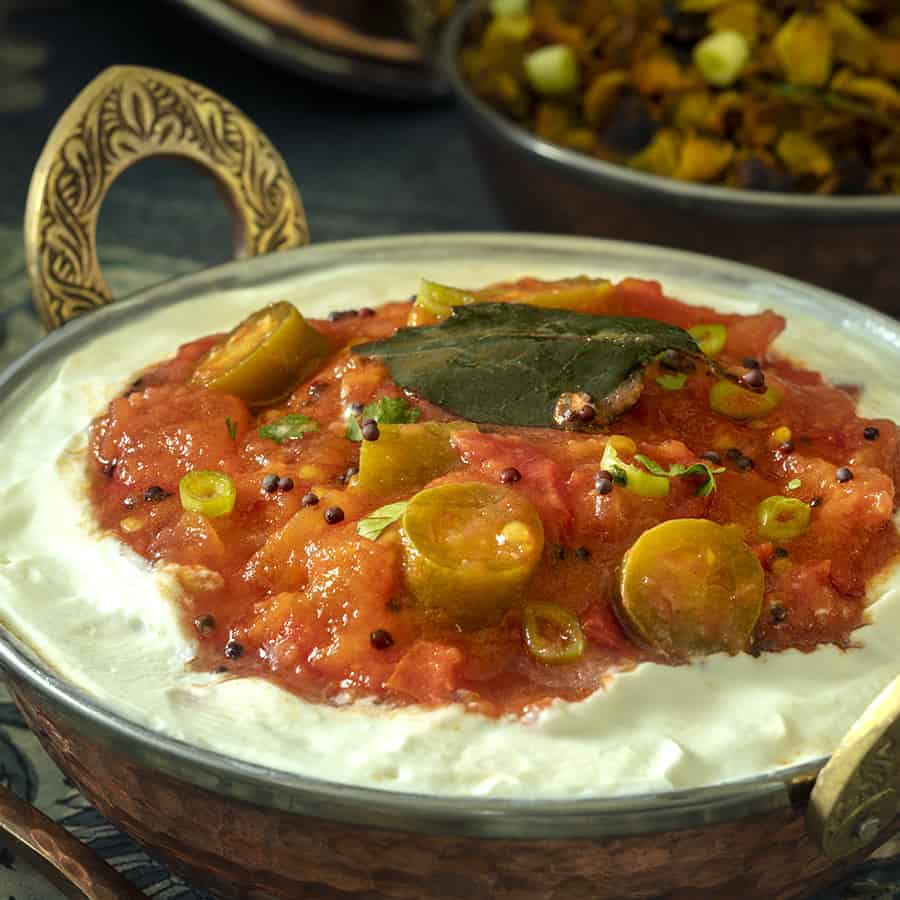 Indian Tomato Salad, a side dish served on Full Fat Yogurt with Serrano peppers and spices.