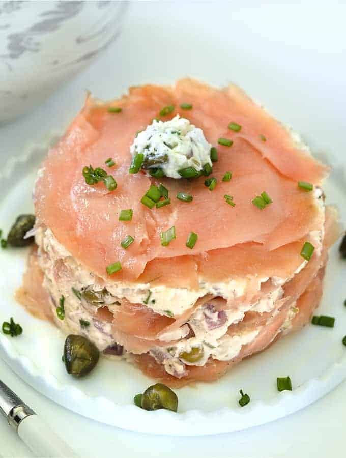 Smoked Salmon Timbale garnished with chives on a white platter