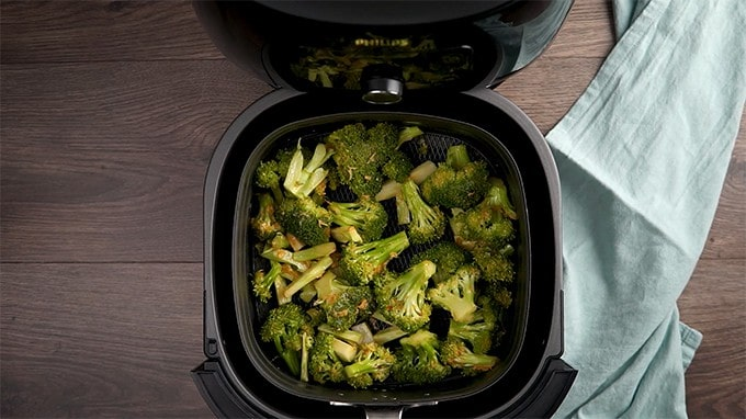 Overhead shot of broccoli in the air fryer.