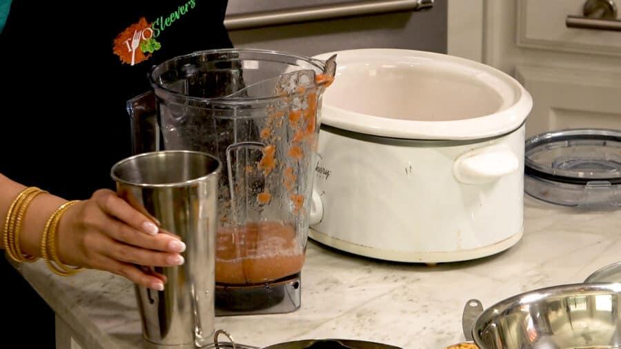 Blender with chana masala sauce.