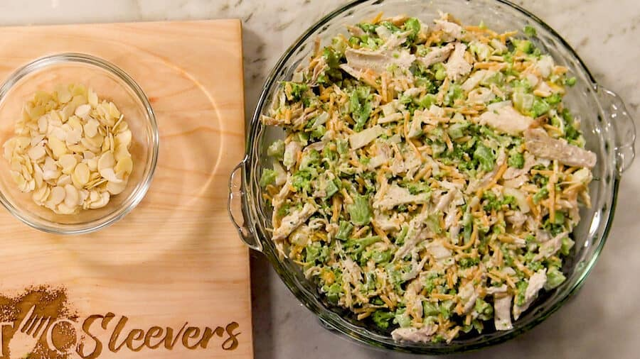 Overhead shot of the mixed Chicken Broccoli Casserole ingredients spread in a 9-inch cake pan.